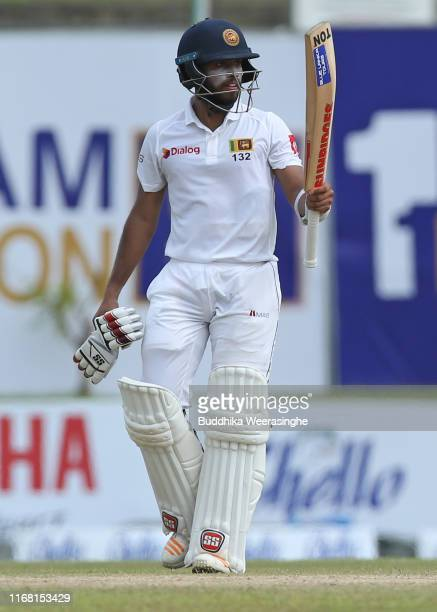Sri Lankan batsman Kusal Mendis celebrates after reaches 50 during the First Test natch between Sri Lanka and New Zealand at Galle International...