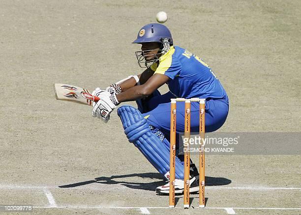 Sri Lankan batsman Magina Thilan Mirando ducks the ball from Zimbabwean bowler Christopher Mpofu at the Harare Sports Club on June 7 2010 in in the...