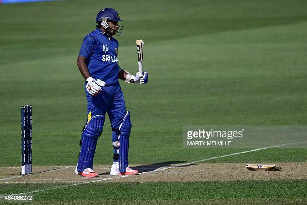 Sri Lankan batsman Mahela Jayawardene reacts after his bat snapped during the Pool A 2015 Cricket World Cup cricket match between Sri Lanka and...