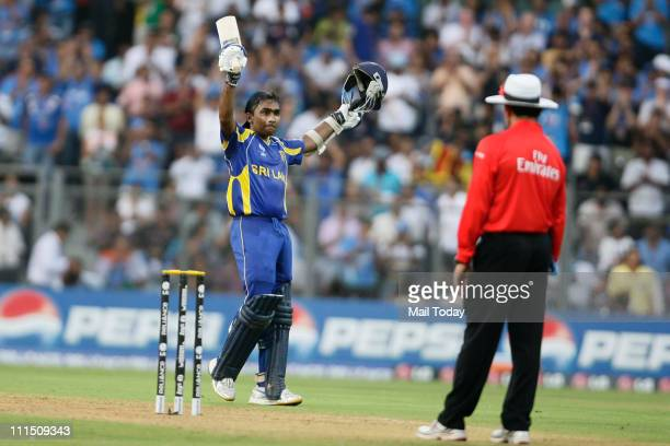 Sri Lankan batsman Mahela Jayawardene waves to the crowd after reaching his century during the ICC Cricket World Cup 2011 Final match at The Wankhede...