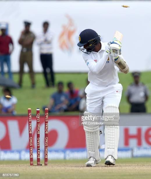 Sri Lankan batsman Nuwan Pradeep is dismissed by Indian bowler Hardik Pandya during the third day of the first Test match between Sri Lanka and India...