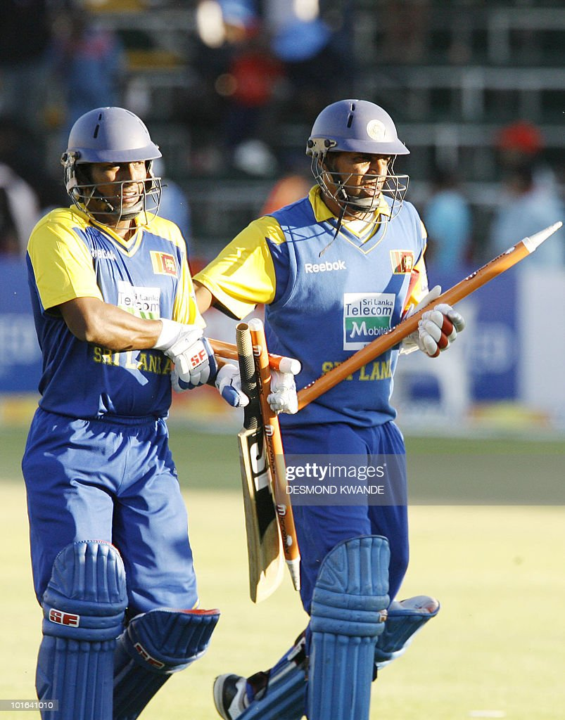 Sri Lankan batsman Thilan Samaraweera (R) and Jeevan Mendis walk off the field after winning the match against india at Harare Sports Club on June 5, 2010 in the fifth match of the Micromax Cup Triangular One-Day Sri lanka won by 6 wickets to book a place in the finals. AFP PHOTO / Desmond Kwande