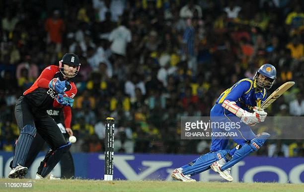 Sri Lankan batsman Upul Tharanga plays a shot past England wicketkeeper Matt Prior during the Cricket World Cup quarter-final match between Sri Lanka...