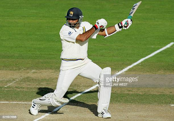 Sri Lankan batsmen Marvan Atapattu slashes at a ball only to be caught after scoring his century against New Zealand on the third day of the first...