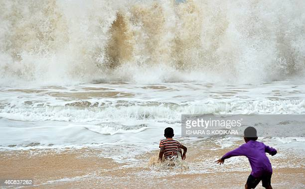 Sri Lankan beachgoers play in the surf in the southern coastal town of Peraliya on December 26 the tenth anniversary of the deadly Asian tsunami The...