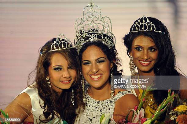 Sri Lankan beauty queen Stephanie Siriwardena poses with first and second runnerup after being crowned Miss Sri Lanka during a glittering contest in...