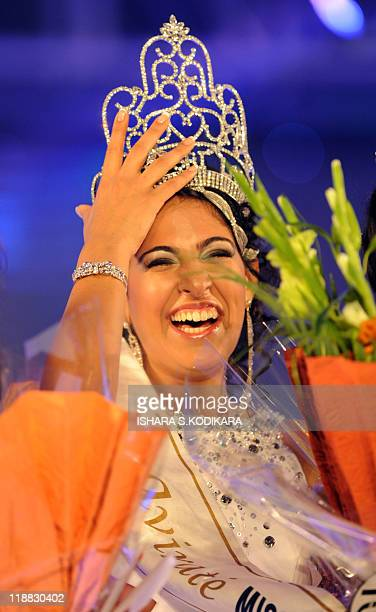 Sri Lankan beauty queen Stephanie Siriwardena reacts as she is crowned Miss Sri Lanka during a glittering contest in Colombo on July 11 2011 The...