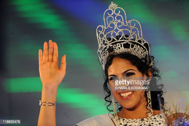 Sri Lankan beauty queen Stephanie Siriwardena waves after being crowned Miss Sri Lanka during a glittering contest in Colombo on July 11 2011 The...
