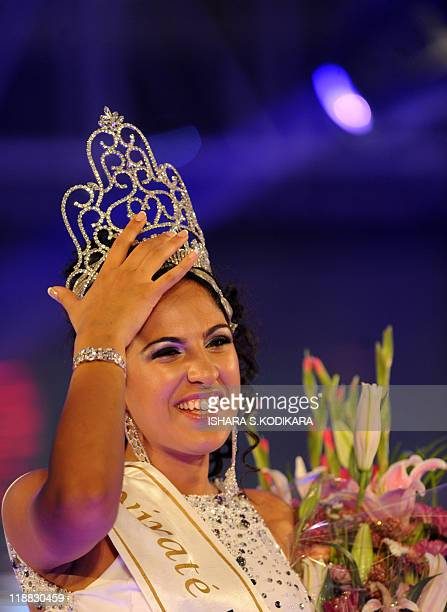 Sri Lankan beauty queen Stephanie Siriwardena waves as she is crowned Miss Sri Lanka during a glittering contest in Colombo on July 11 2011 The...