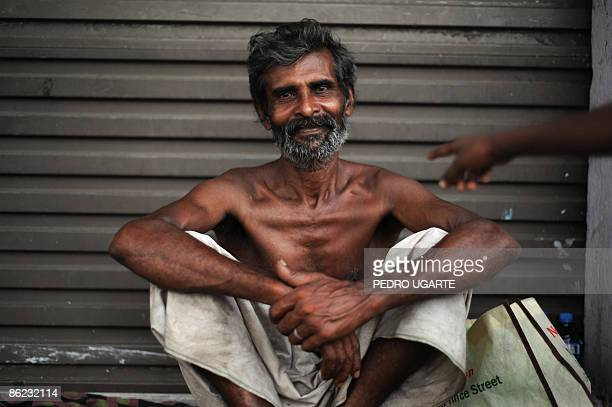 A Sri Lankan beggar poses for a picture in Colombo on April 26 2009 The central bank said beginning of April that economic expansion in warbattered...