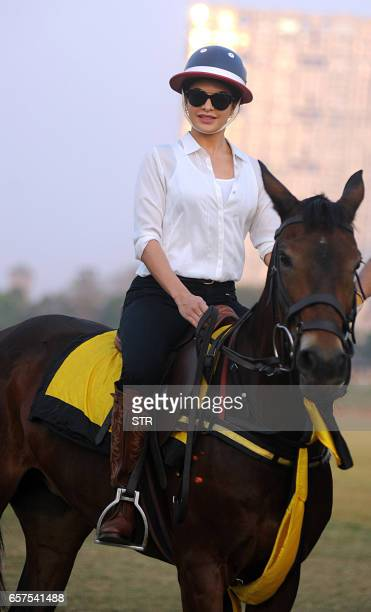 Sri Lankan Bollywood actress Jacqueline Fernandez poses with a pony during a polo tournament hosted by The Amateur Riders Club in Mumbai on March 24...