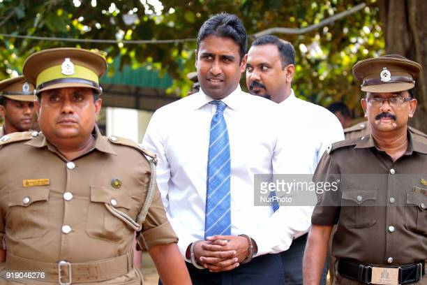 Sri Lankan Bond dealer Arjun Aloysius who is embroiled in an insider trading scam at Sri Lanka's Central Bank walks into a Magistrate Court escorted...