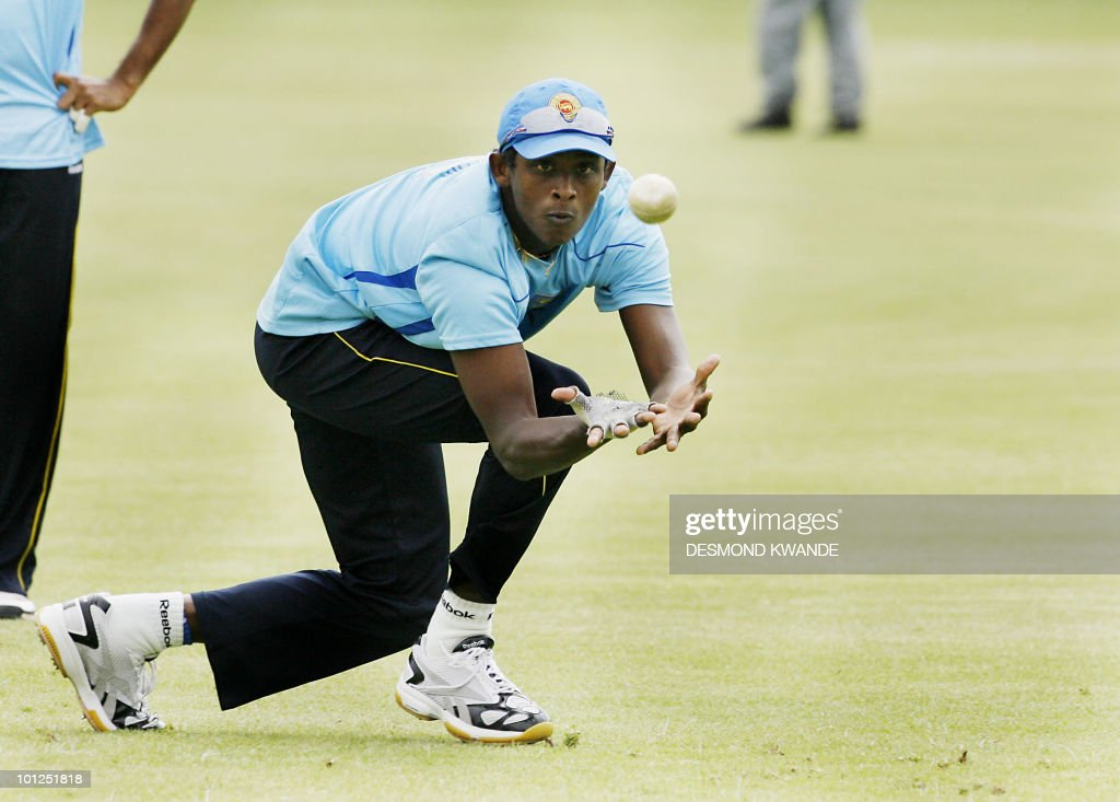 Sri lankan bowler Ajantha Mendis takes a catch during a practice session in Bulawayo at Queens Sports Club on May 29, 2010. Sri lanka will be playing India on Sunday May 30th 2010 in the second match of the Micromax Cup Triangular One-Day International series that also includes the host Zimbabwe. AFP PHOTO / Desmond Kwande