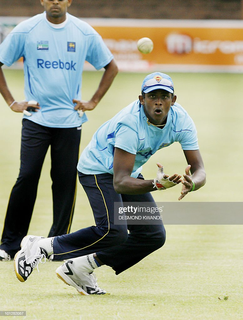 Sri lankan bowler Ajantha Mendis takes a catch during a practice session in Bulawayo at Queens Sports Club on May 29, 2010. Sri lanka will be playing India on Sunday May 30th 2010 in the second match of the Micromax Cup Triangular One-Day International series that also includes the host Zimbabwe . AFP PHOTO / Desmond Kwande