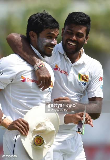 Sri Lankan bowler Lahiru Kumara celebrates with teammate Dhananjaya de Silva after dismissing Indian batsman Hardik Pandya during the second day of...