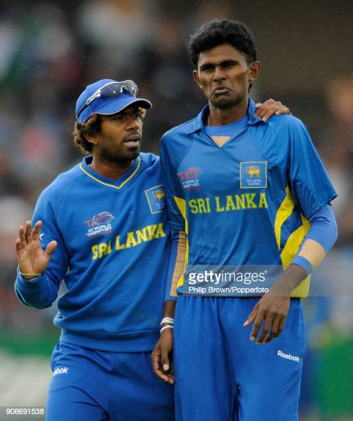Sri Lankan bowler Lasith Malinga gives some advice to teammate Isuru Udana during the ICC World Twenty20 group match between Sri Lanka and West...