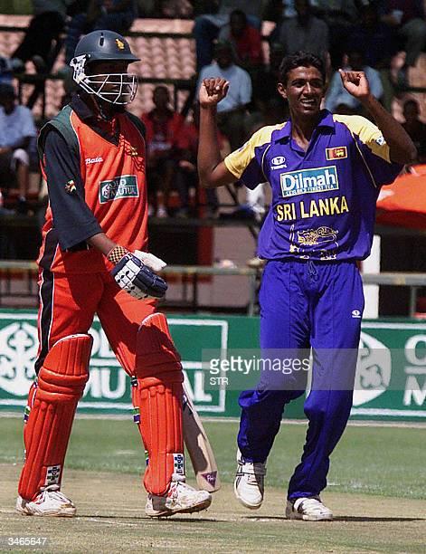 Sri lankan bowler Mohamed Maharoof right celebrates Zimbabwes last wicket of Tinashe Panyangara at Harare Sports Club 25 April 2004 Zimbabwe scored...