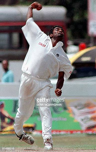 Sri Lankan bowler Muttaiah Muralitharan bowles during the Third day of the first cricket test against South Africa in Galle International cricket...