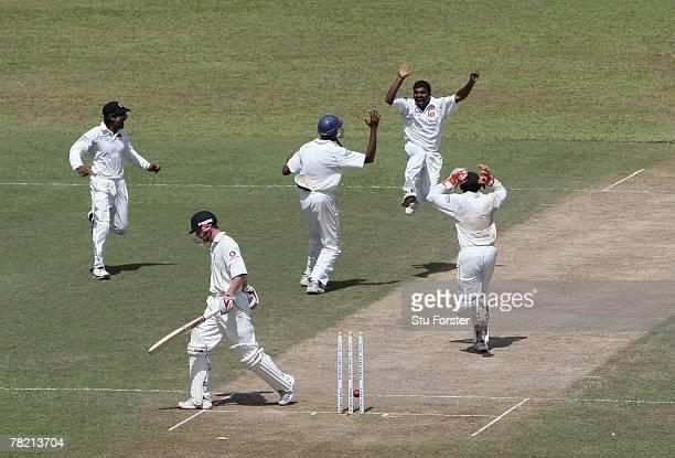 Sri Lankan bowler Muttiah Muralitharan celebrates after taking his World Record 709th Test wicket, that of England batsman Paul Collingwood during...