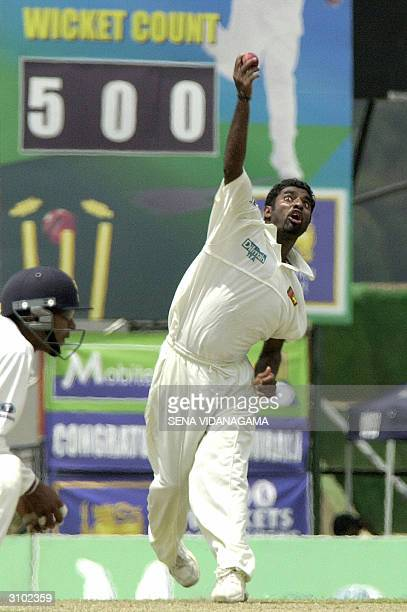 Sri Lankan bowler Muttiah Muralitharan delivers a ball during the second day of the second test match between Australia and Sri Lanka at Asgiriya...