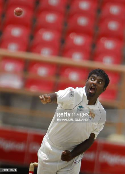 Sri Lankan bowler Muttiah Muralitharan delivers during the third day of the first Test match between the West Indies and Sri Lanka in Georgetown on...