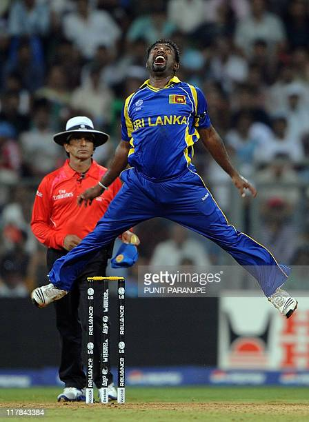 Sri Lankan bowler Muttiah Muralitharan jumps in the air as he celebrates after taking the wicket of New Zealand batsman Scott Styris during the match...