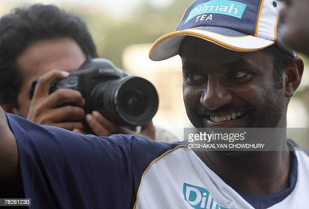 Sri Lankan bowler Muttiah Muralitharan waves to fans at the end of the final day of the first Test match against England at Asgiriya Stadium in Kandy...