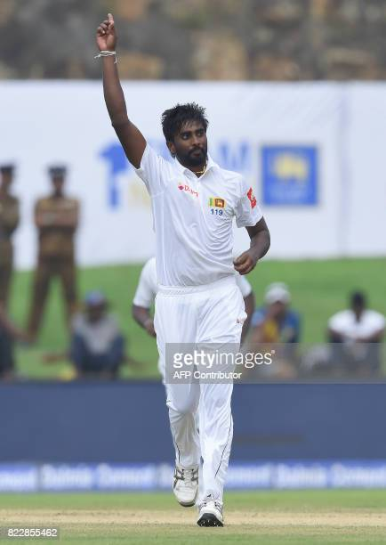 Sri Lankan bowler Nuwan Pradeep celebrates after he dismissed Indian batsman Abhinav Mukund during the first day of the first Test match between Sri...