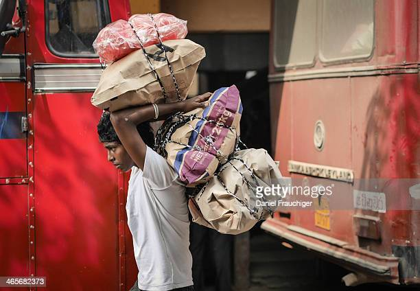 CONTENT] Sri Lankan boy carrying heavy bags at the Colombo Central Bus Station In Colombo Sri Lanka November 29 2013