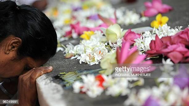 A Sri Lankan Buddhist devotee offers prayers on Poyafull moon at the Kelaniya Temple in Kelaniya Gampaha district on January 29 2010 The...