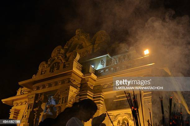 A Sri Lankan Buddhist devotee prays during Poya a religious day for the full moon at a temple in Colombo on October 27 2015 The predominantly...