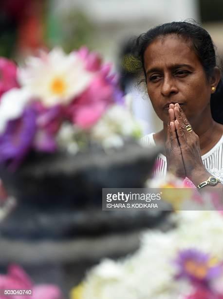Sri Lankan Buddhist devotee prays to bring in the New Year at the Kelaniya Temple in Kelaniya on January 1, 2016. Many Sri Lankans marked the...