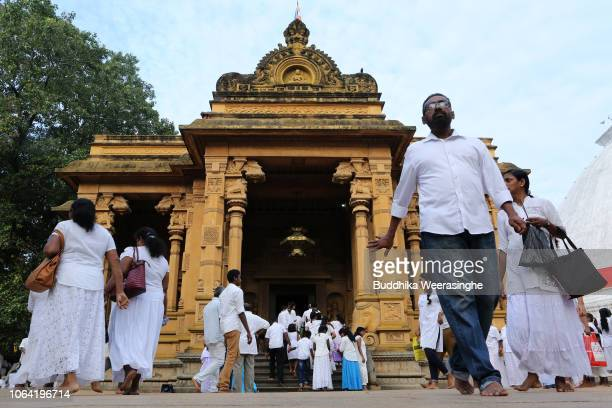 Sri Lankan Buddhist devotees attend to mark Poya day or Full Moon Day at a temple on November 22 2018 in Colombo Sri Lanka Buddhists who make up 60...