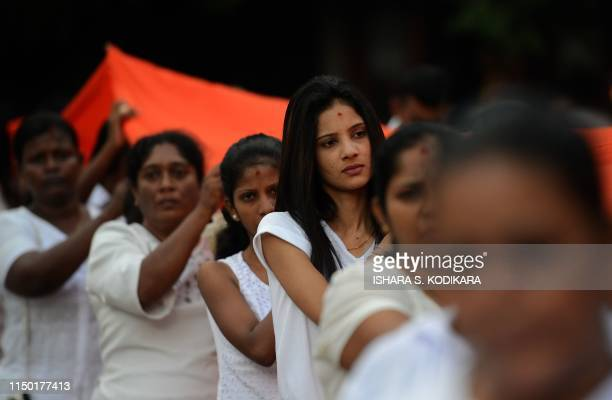 Sri Lankan Buddhist devotees offer a saffron cloth in Kelaniya temple on June 16 during Poya a full moon religion festival Sri Lanka celebrates Poson...