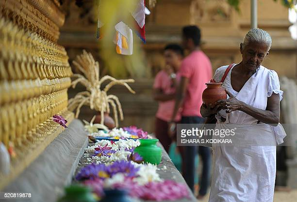 Sri Lankan Buddhist devotees offer prayers at a Kelaniya Buddhist Temple in celebration of the traditional Sinhala and Tamil New Year in Colombo on...