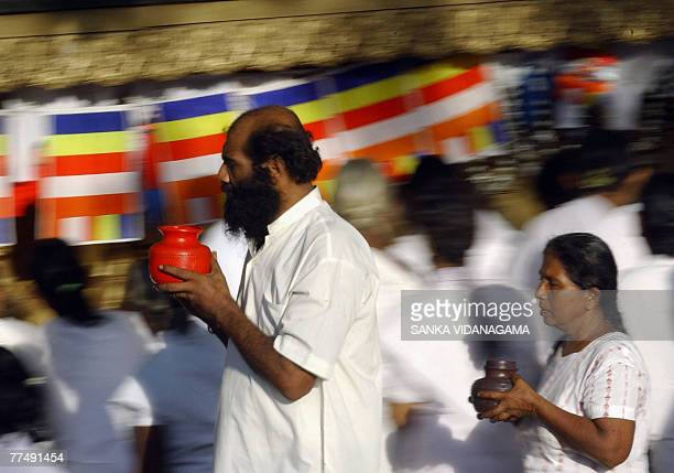Sri Lankan Buddhist devotees offer prayers at a temple in Kelanya a suburb of Colombo 25 October 2007 to celebrate Vap Poya or full moon day which is...