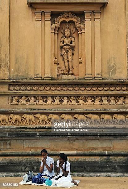 Sri Lankan Buddhist devotees offer prayers at the Kelani temple in the Kelaniya suburb of Colombo on March 21 2008 to celebrate 'Medin' Poya day or...
