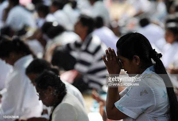 Sri Lankan Buddhist devotees offer prayers during the public holiday Poya Day at the Kelaniya Temple in Kelaniya on September 22 2010 The...