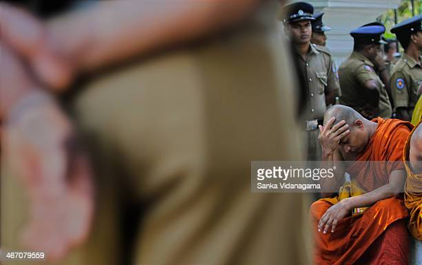 Sri Lankan Buddhist monk from the hard-line Buddhist group, Sinhala Ravaya, reacts after their demonstration was forcefully stopped by police...