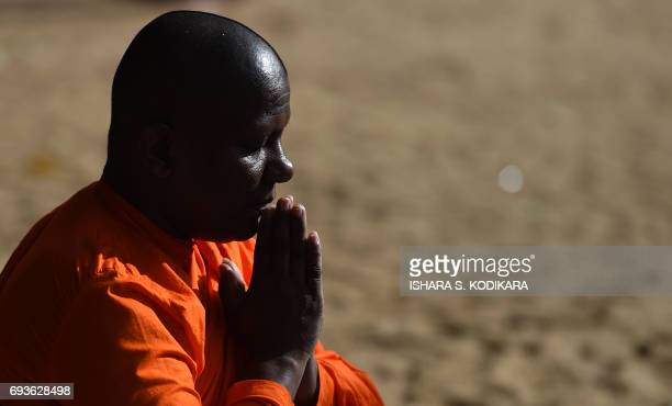 A Sri Lankan Buddhist monks prays at Kelaniya Temple during the Poson Festival in the Colombo suburb of Kelaniya on June 8 2017 Sri Lanka celebrates...
