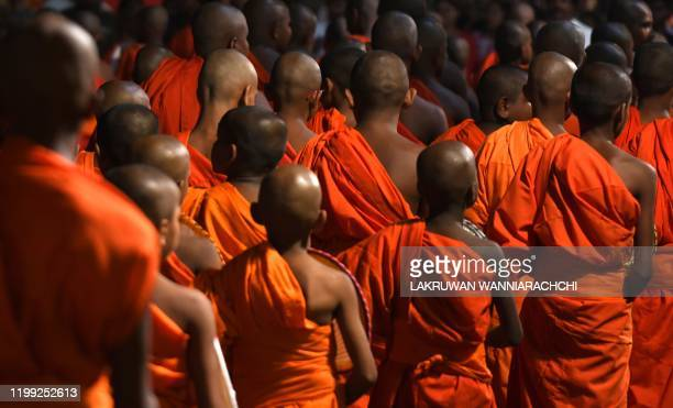 Sri Lankan Buddhist monks take part in a procession in front of the Gangarama Temple during the Navam Perahera festival in Colombo February 7, 2020....