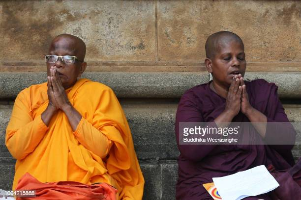 Sri Lankan Buddhist nuns pray and meditate as they mark Poya day or Full Moon Day at a temple on November 22 2018 in Colombo Sri Lanka Buddhists who...