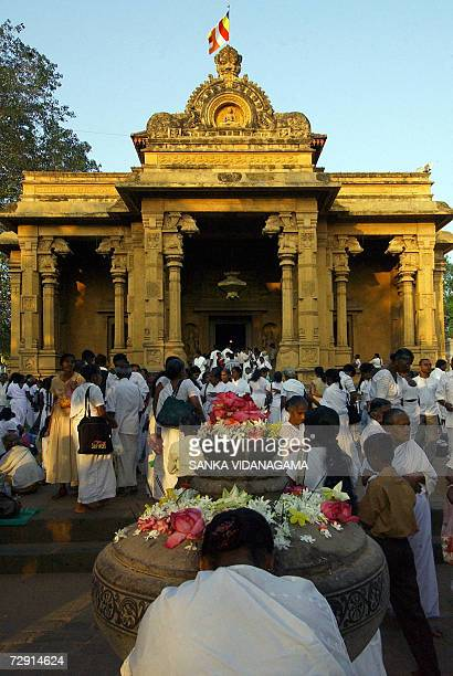 Sri Lankan Buddhists offer prayers at the Kelani temple in the Kelaniya suburb of Colombo 03 January 2007 as they celebrate Duruthu Poya day Full...