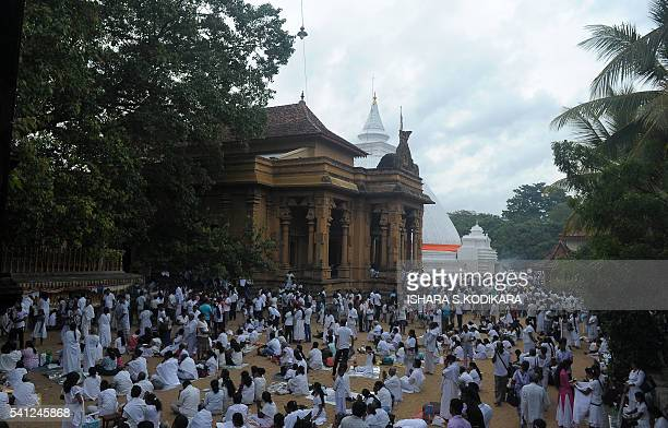 Sri Lankan Buddhists pray during Poya a full moon religion festival at the Kelaniya Temple in Kelaniya on June 19 2016 Sri Lanka celebrates Poson a...