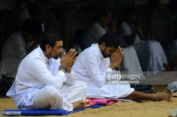 Sri Lankan Buddhists pray in Kelaniya temple on June 16 during Poya a full moon religion festival Sri Lanka celebrates Poson a Buddhist festival...