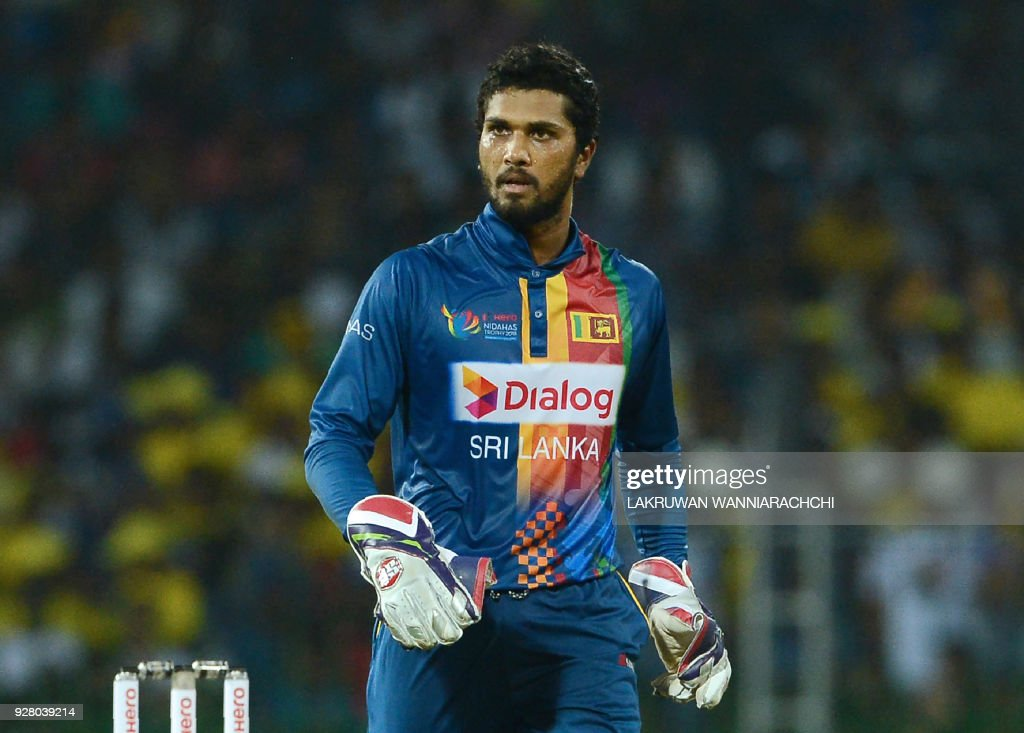 Sri Lankan captain and wicketkeeper Dinesh Chandimal looks on during the opening Twenty20 international cricket match between Sri Lanka and India of the Nidahas Trophy tri-nation Twenty20 tournament at the R. Premadasa stadium in Colombo on March 6, 2018. The Nidahas Trophy tri-nation Twenty20 tournament involving Sri Lanka, Bangladesh and India. /