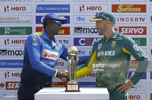 Sri Lankan captain Angelo Mathews and South African captain Faf Du Plessis shake hands after unveiling the trophy during the 1st One Day...