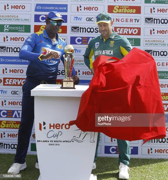 Sri Lankan captain Angelo Mathews and South African captain Faf Du Plessis unveil the trophy during the 1st One Day International cricket match...