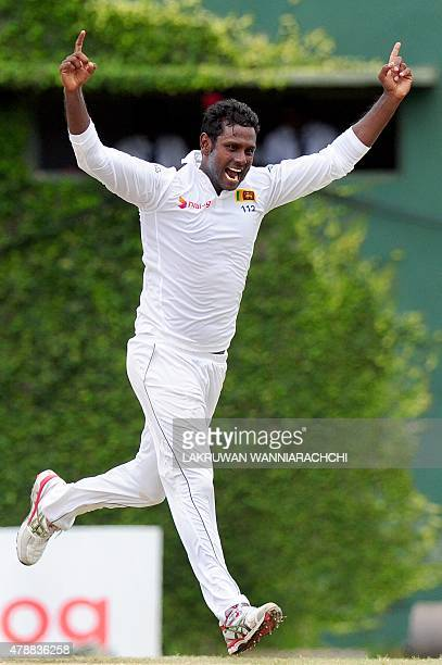 Sri Lankan captain Angelo Mathews celebrates the wicket of Pakistan cricketer Younis Khan during the fourth day of the second Test match between Sri...