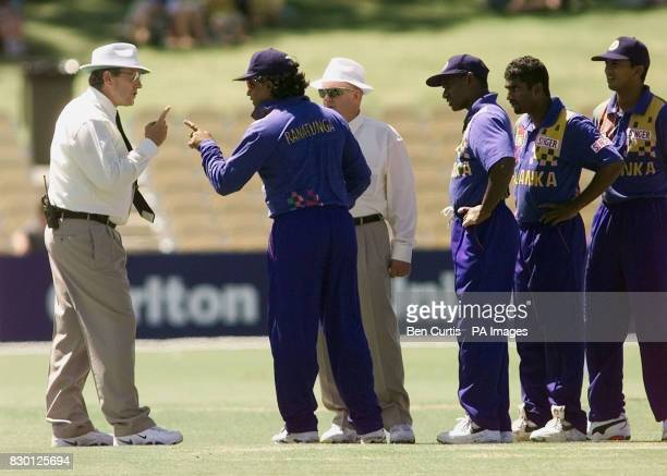 Sri Lankan Captain Arjuna Ranatunga engages in heated discussion with umpires Ross Emerson and Anthony McQuillan after bowler Muttiah Muralitharan...